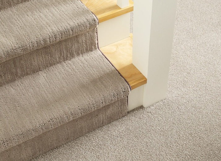 Cohesive look for staircase and room carpeting by Shaw Floors